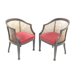 Pair Early 20th century Georgian style mahogany bergere armchairs, square tapering supports carved with husks, upholstered drop in seat cushions, W56cm