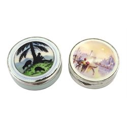 Silver enamel circular compact, the lid decorated with a silhouette of a Shepherd playing a recorder and sheep by Cohen & Charles, London 1920 and one other, the lid decorated with a Venetian landscape, by H C Freeman Ltd, London import marks 1927 and one other, (2)