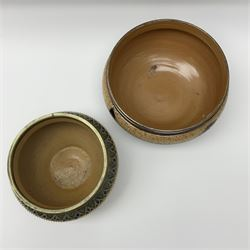 Two 19th century Doulton Lambeth bowls, each with silver plated rims, the first example decorated with vine leaves against a ditsy foliate backdrop, with impressed marks and monogrammed for George Hugo Tabor beneath, H13.5cm D23.5cm, the second example decorated with various foliate bands, with impressed marks and monogrammed for Louise E Edwards beneath, H13.5cm D17.5.