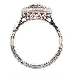 Platinum target design ruby and diamond ring, old cut central diamond of approx 0.50 carat,, with calibre cut ruby surround and diamond set shoulders