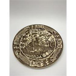 Early 19th century David Dunderdale & Co Castleford pottery plate, decorated in brown in the Buffalo and Ruins pattern, with indistinct impressed marks beneath, D24cm, together with a late 18th/early 19th century blue and white pearlware sauce boat, decorated in a variant of the Willow pattern, L15cm
