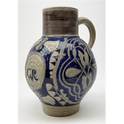 An 18th century Westerwald stoneware flagon, the bulbous body with moulded GR Royal cypher beneath a crown, and further detailed with incised foliate decoration, H25cm.