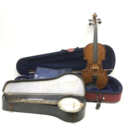 The Stentor Student II violin with 35.5cm two-piece maple back and ribs and spruce top, bears label, 59cm overall, in fitted carrying case with bow; and a small eight-string mandolin banjo with ebonised back and sides and mahogany neck L51cm, cased (2)