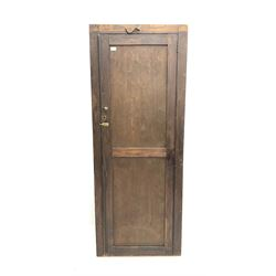 Early 20th century large stained pine school cupboard, single panelled door enclosing shelving