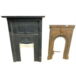 Early 20th century cast iron fireplace, adjustable hood set with Yorkshire Rose, and another cast iron inset