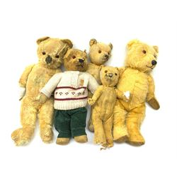 Five English teddy bears c1930s-50s including wood wool filled Chiltern bear with swivel jointed head, glass eyes, plastic dog type nose, inoperative musical movement and jointed limbs with velvet pads H16.5