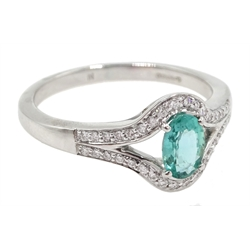 18ct white gold oval emerald and diamond ring, hallmarked, emerald approx 0.50 carat