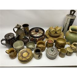 A group of assorted Studio Pottery, to include part dinnerware set comprising four dinner plates, four side plates, two jugs, preserve pot, gravy pan, and four soups bowls, together with a large green glazed jug, small butter jar, etc., of various form and decoration, various makers marks.