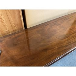 20th century Georgian style mahogany wake table, oval drop leaf top, double gate action base on each side, six square supports with inner chamfered edge and outer moulded edge