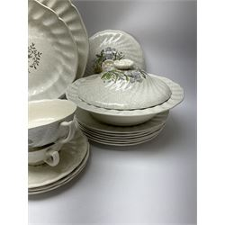 Royal Doulton dinner wares decorated in the Sutherland pattern, comprising two serving platters, one tureen and cover, six twin handled soup bowls and saucers, eight bowls, six dinner plates, seven side plates, and jug.