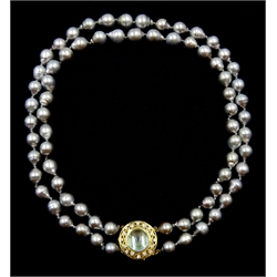 Double strand Tahitian pearl necklace, seventy-two cultured pearls, on a gold cabochon blue topaz and diamond openwork clasp stamped 18K 750