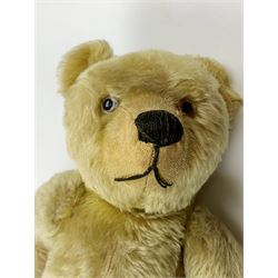 Chad Valley large teddy bear c1930s with wood wool filled blond mohair body, jointed swivel head with glass eyes, shaved muzzle with vertically stitched nose and mouth and jointed limbs H21