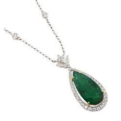 18ct white and yellow gold emerald and diamond necklace, the pear shaped emerald of 9.58 carat, with round brilliant cut diamond surround and bail and four diamonds set within the chain, stamped 750, with World Gemological Institute Report
