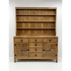 'Mouseman' adzed oak dresser, raised three heights plate rack, six drawers and two cupboards, carved with mouse signature, by Robert Thompson of Kilburn